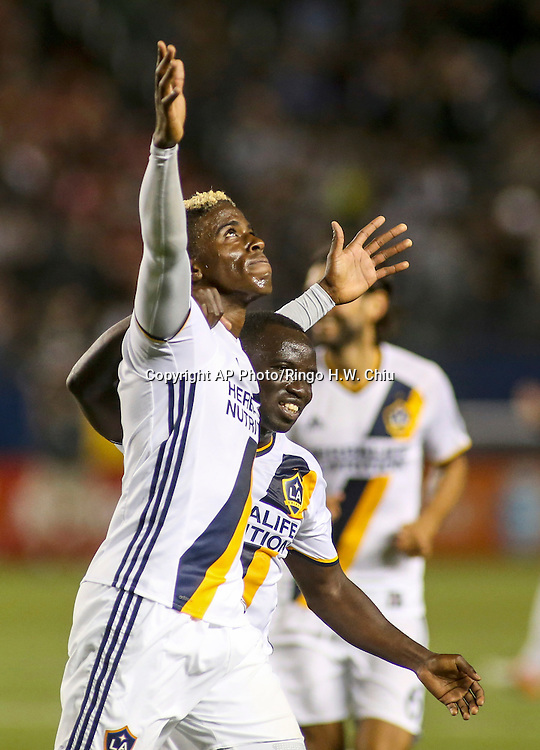 Los Angeles Galaxy forward Gyasi Zardes, left, celebrates a goal with his teammate Emmanuel Boateng in the first half of an MLS soccer game in Carson, Calif., Saturday, April 23, 2016. (AP Photo/Ringo H.W. Chiu)