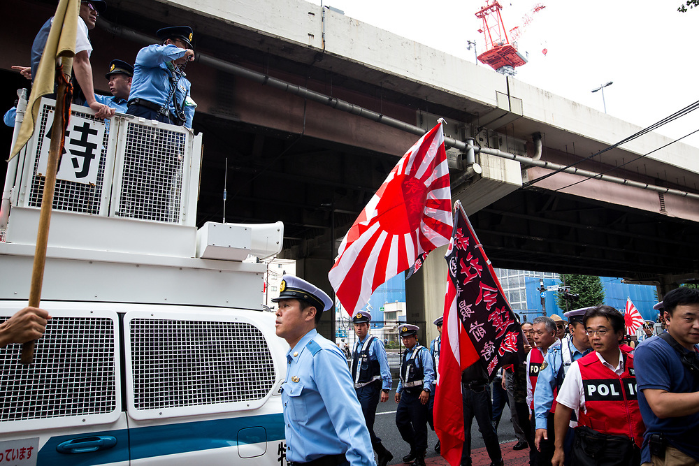 "TOKYO, JAPAN - JULY 16: Japanese nationalists holding Japanese flags took to the streets in a ""hate demonstration"" in Akihabara, Tokyo, Japan on July 16, 2017. The nationalists faced off with anti-racist groups who mounted counter protests demanding an end to hate speech and racism in Japan. (Photo by Richard Atrero de Guzman/AFLO)"