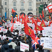 LONDON, ENGLAND - APRIL 11: Protesters stage a mass rally through central London on April 11, 2009 in London, England. Thousands of protestors staged a rally in central London today against alleged human rights abuses in Sri Lanka. The protesters waved flags of the Tamil Tigers, who face a threatened final assault by government forces....***Standard Licence  Fee's Apply To All Image Use***.Marco Secchi /Xianpix. tel +44 (0) 845 050 6211. e-mail ms@msecchi.com or sales@xianpix.com.www.marcosecchi.com