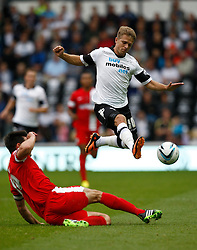 Derby County's Jamie Ward skips over a tackle from Blackburn Rovers' Scott Dann - Photo mandatory by-line: Matt Bunn/JMP - Tel: Mobile: 07966 386802 04/08/2013 - SPORT - FOOTBALL -  Pride Park Stadium - Derby -  Derby County v Blackburn Rovers - Sky Bet Championship