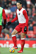 Liverpool defender Virgil van Dijk (4) warming up during the Premier League match between Liverpool and Watford at Anfield, Liverpool, England on 17 March 2018. Picture by Craig Galloway.