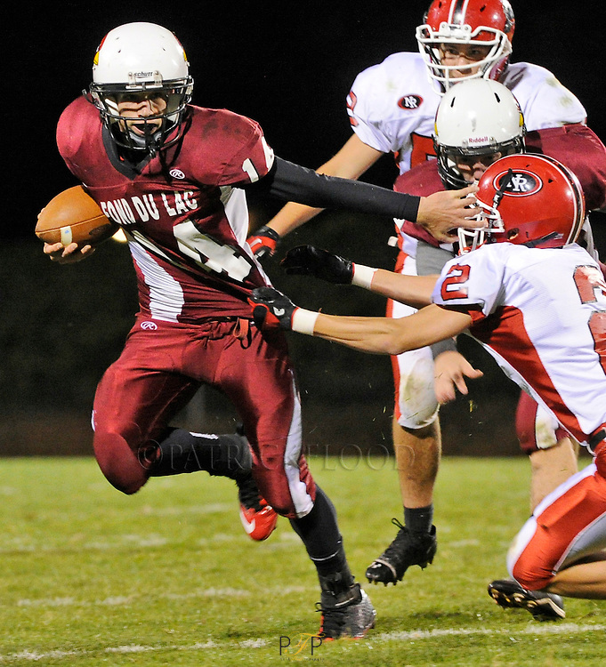 #14 Andy Mathews of Fondy, fends off a tackler during their game against Neenah at Fruth field in Fond du Lac. Friday, September 21, 2012. Patrick Flood/The Reporter.