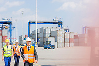 Engineers walking in shipping yard