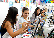 Reality TV dating star Andi Dorfman and her friend Ashley Cook, left, accessories designer, embrace girl time with a housewarming event at the Painting Lounge hosted by Palm Breeze, a new tropical sparkling alcohol spritz from Mike's Hard Lemonade Co., Thursday, Aug. 6, 2015 in New York. (Diane Bondareff/AP Images for Palm Breeze)