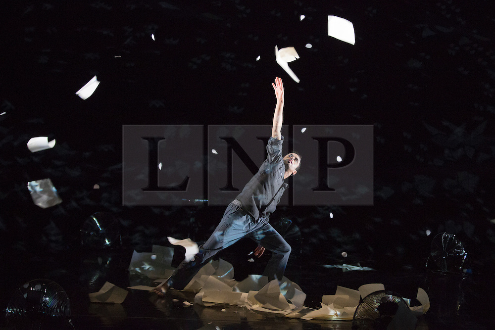 © Licensed to London News Pictures. 23/01/2015. London, England. Aakash Odedra dances with flying paper. London Premiere of Aakash Odedra's new double bill at the Linbury Studio Theatre, Royal Opera House, London. Aakash Odedra performs his latest work Murmur (part of a double bill with Damien Jalet's 'Inked'). Aakash Odedra collaborates with Australian choreographer Lewis Major and Farooq Chaudhry as dramaturg. Photo credit: Bettina Strenske/LNP