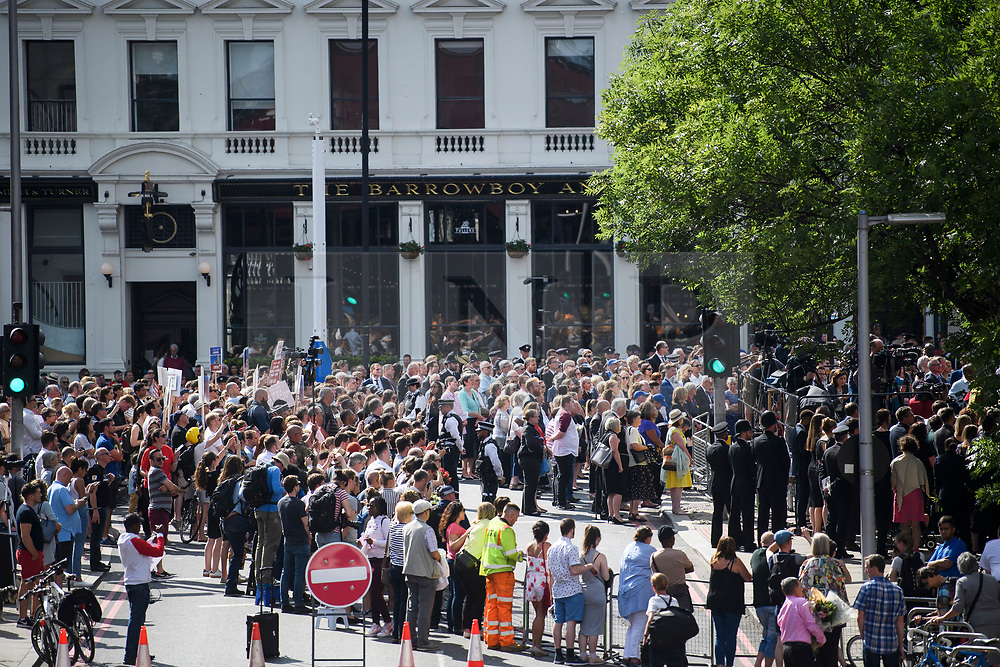 © Licensed to London News Pictures. 03/06/2018. London, UK. Thousand of people gather to honour a minutes silence for the victims of the 2017 London Bridge Terror attack, held on London Bridge. Eight people were killed and 48 were injured when a van was deliberately driven into pedestrians on London Bridge. Three occupants then ran to the nearby Borough Market area carrying knives and fake explosives. Photo credit: Ben Cawthra/LNP