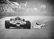 After completing two laps driving nearly blind in the rain, Gilles Villeneuve&rsquo;s Ferrari finally sheds it&rsquo;s broken nose wing as Villeneuve splashes to a heroic third place at the 1981 Canadian Grand Prix in Montreal. <br />