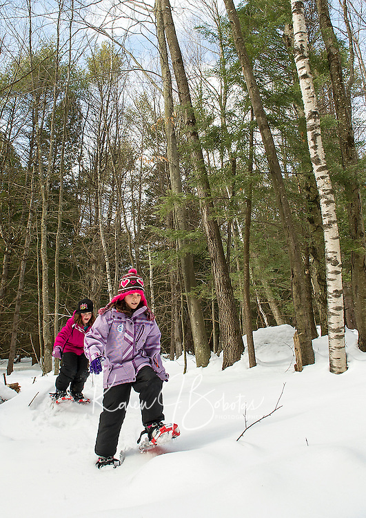 Katie Westcott and Madison Monier enjoyed snowshoeing for their very first time together with perfect conditions during Winter Fest activities at Prescott Farm on Saturday.  (Karen Bobotas/for the Laconia Daily Sun)