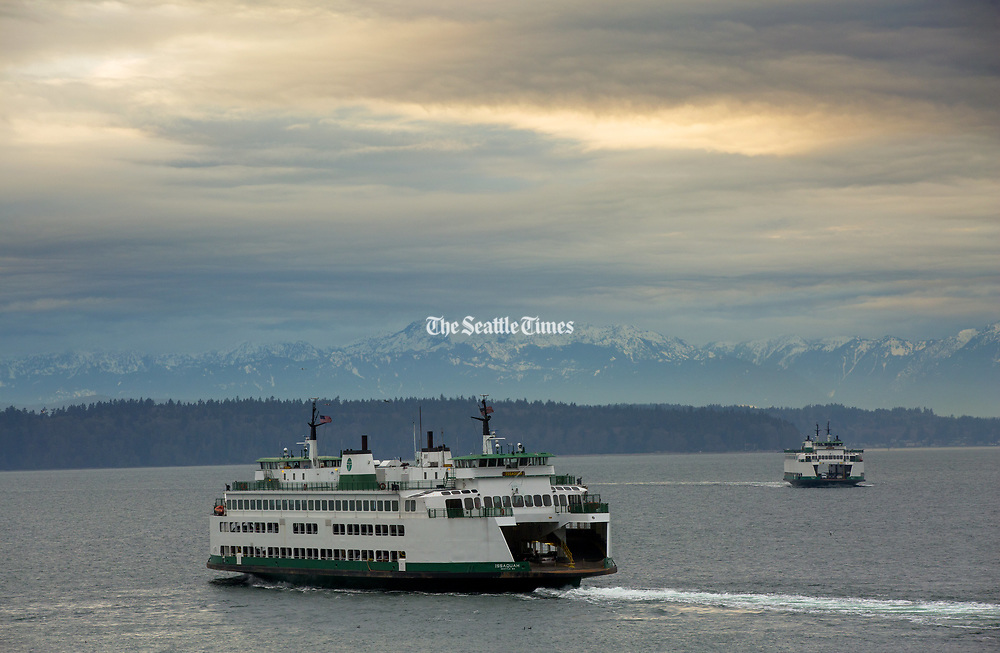 The Issaquah ferry, coming from the Fauntleroy dock in West Seattle (left),  heads towards Vashon Island  while the Sealth ferry heads from Southworth to Fauntleroy. (Ellen M. Banner / The Seattle Times)