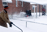 Chuck Gambill (left) uses a manual snow shovel in his driveway, as his sons Alex (center) and Eric (right) use snowblowers and help neighbors in the Belmont area of Dayton early Tuesday morning, before the snow turned to ice.  Chuck says that they help out about 4 neighbors on a regular basis.