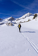 Backcountry skier under Mount Abbott in Little Lakes Valley, Inyo National Forest, Sierra Nevada Mountains, California
