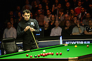 20.02.2016. Cardiff Arena, Cardiff, Wales. Bet Victor Welsh Open Snooker. Ronnie O'Sullivan versus Joe Perry. Ronnie O'Sullivan surveys the table.