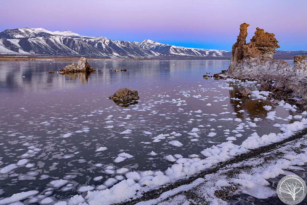 Morning after the big storm, twilight colors in the sky above mountains of the Eastern Sierra and Mono Lake tufas, near Lee Vining, California