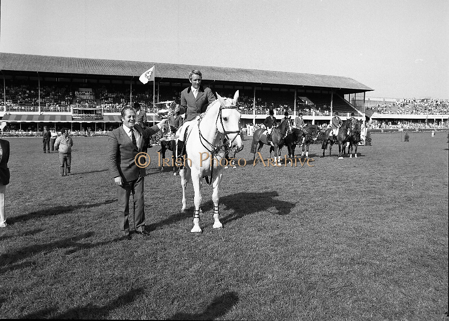 The Dublin Horse Show.1982.07.08.1982.08.07.1982.7th August 1982...The Dublin Horse Show..R.D.S., Ballsbridge, Dublin.The winners of the Aga Khan team trophy were Great Britain. The shows' leading rider was Mr Harvey Smith, Great Britain. .Picture of the winning captain Mr David Broome accepting the trophy from The Minister for Agriculture Mr Brian Lenihan T.D.
