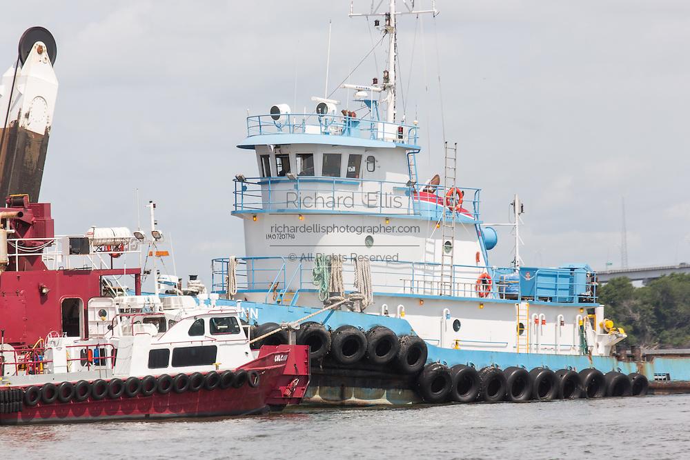 A tugboat pushing a barge in Charleston Harbor June 26, 2013 in Charleston, South Carolina.