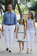 MALLORCA, SPAIN, 2016, AUGUST 04 <br /> <br /> Like mother like daughter! Queen Letizia of Spain colour-coordinates with her husband and mini-me princesses for their annual holiday on Mallorca<br /> <br /> Colour-coordinated in matching blue and white, Queen Letizia's daughters are spitting image of their mother in these charming holiday photos.<br /> Letizia joined her husband King Felipe VI, along with their daughters, Crown Princess Leonor and Princess Sofía this week at the Marivent Palace on the island of Mallorca, where the family are spending their annual summer holiday.<br /> ©Exclusivepix Media
