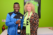 Match sponsors Viva represented by Juliet Getalley present a bottle of Champagne to Man of the Match Forest Green Rovers midfielder Drissa Traore (4) during the Vanarama National League match between Forest Green Rovers and Dagenham and Redbridge at the New Lawn, Forest Green, United Kingdom on 29 October 2016. Photo by Alan Franklin.