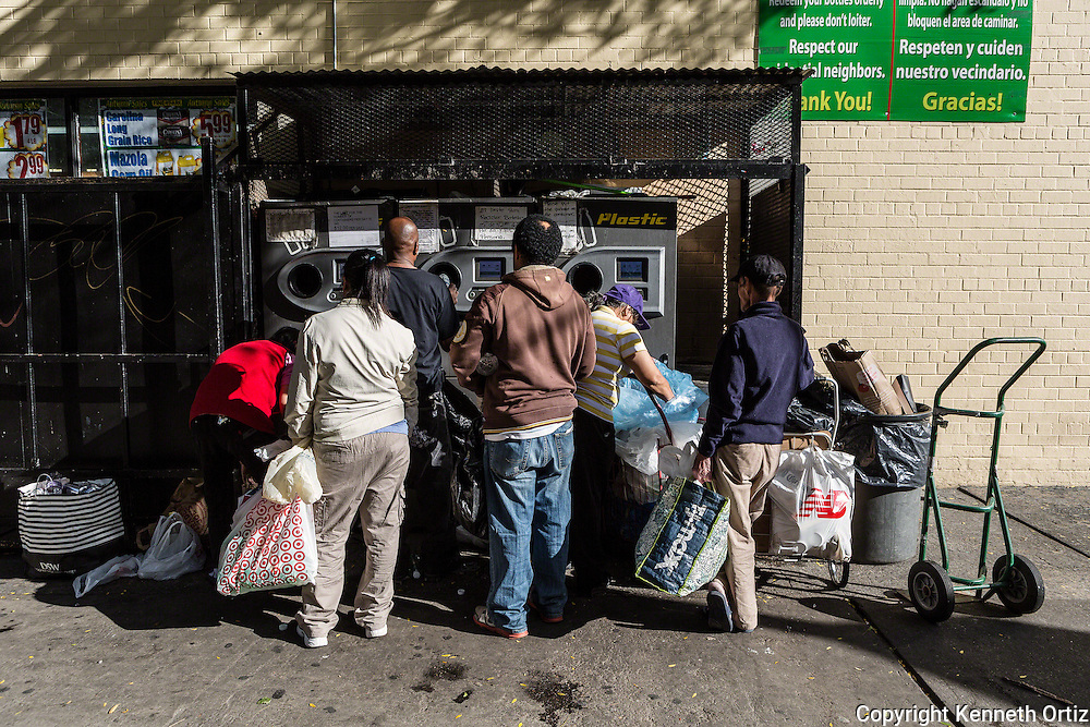 Lower East side residents returning bottles for recycling at the local supermarket.