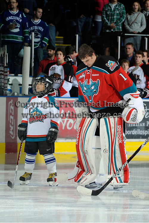 KELOWNA, CANADA, OCTOBER 26:  The Pepsi Save-On Foods player of the game lines up with Adam Brown #1 of the Kelowna Rockets as the Prince George Cougars visit the Kelowna Rockets  on October 26, 2011 at Prospera Place in Kelowna, British Columbia, Canada (Photo by Marissa Baecker/Shoot the Breeze) *** Local Caption *** Adam Brown;