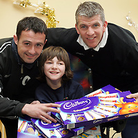 David Hannah and Jim Weir from St Johnstone FC pictured with Demi-Lee Ellis (12) a pupil at the Glebe School, Scone near Perth. Any fines that were imposed on players at St Johnstone by John Connolly and Jim Weir over the last few weeks were to be paid in selection boxes that have been donated to Glebe School and the childrens ward at the Perth Royal Infirmary.<br />see story by Gordon Bannerman Tel: 01738 553978 or 07729 865788<br />Picture by Graeme Hart.<br />Copyright Perthshire Picture Agency<br />Tel: 01738 623350  Mobile: 07990 594431