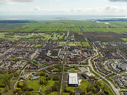 Nederland, Noord-Holland, Gemeente Purmerend, 16-04-2012; zicht op polder De Purmer langs de as van de Purmerenderweg, links de wijk Purmer-Noord, rechts de Purmer-Zuid. Op het tweede plan van links naar rechts: golfterrein, Purmerbuurt, Purmerbos. In de achtergrond de oorspronkelijke verkaveling van de polder langs de Oosterweg..View on polder the Purmer and the city of Purmerend. In the back the Markermeer (lake). .luchtfoto (toeslag), aerial photo (additional fee required);.copyright foto/photo Siebe Swart