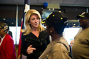 State Senator Wendy Davis speaks with Carnisha Campbell, an Army veteran, at Luby's in Forrest Hill during their Veterans Day Breakfast on November 11, 2013.  (Cooper Neill / for The Texas Tribune)