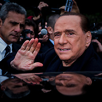 Arcore, Italy - 04-04-2016: Former prime minister of Italy and President of the political party 'Forza Italia', Silvio Berlusconi waves from his car at the end of the opening ceremony of a pedestrian-bicycle lane.