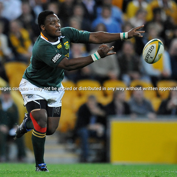 Chiliboy Ralepelle passes from the base of the ruck late in the match for South Africa during action from the Tri-Nations Rugby Test Match played between Australia and South Africa at Suncorp Stadium (Brisbane, Australia) on Saturday 24th July 2010<br /> <br /> Conditions of Use : This image is intended for Editorial use only (news or commentary, print or electronic) - Required Images Credit &quot;Steven Hight - Auraimages/Photosport