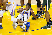 Golden State Warriors guard Ian Clark (21) reacts to falling on the court during a lay up attempt against the Utah Jazz at Oracle Arena in Oakland, Calif., on December 20, 2016. (Stan Olszewski/Special to S.F. Examiner)
