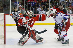 March 19, 2008; Newark, NJ, USA;  New Jersey Devils goalie Martin Brodeur (30) makes a glove save while New Jersey Devils defenseman Colin White (5) covers New York Rangers center Chris Drury (23) during the first period at the Prudential Center in Newark, NJ.