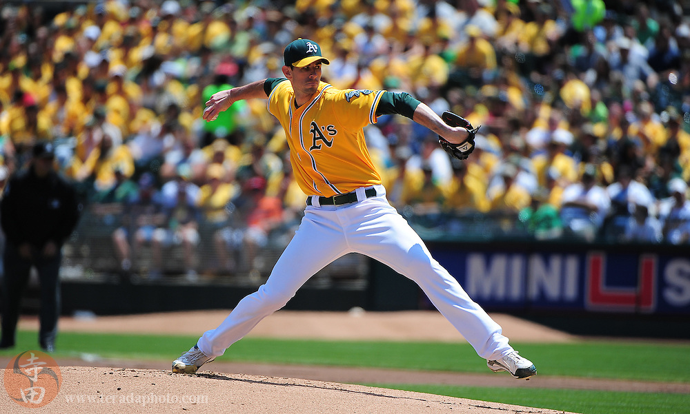 July 31, 2011; Oakland, CA, USA; Oakland Athletics starting pitcher Brandon McCarthy (32) delivers a pitch during the first inning against the Minnesota Twins at O.co Coliseum. The Athletics defeated the Twins 7-3. Mandatory Credit: Kyle Terada-Terada Photo