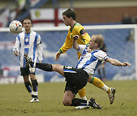 Photo: Aidan Ellis.<br /> Sheffield Wednesday v Norwich City. Coca Cola Championship. 15/04/2006.<br /> Sheffield's John Hills clears from Norwich's Ian Henderson