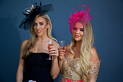 LIVERPOOL, ENGLAND - Thursday, April 6, 2017: Georgia Cook, 22 from Wavertree and Kate Comer, 21 from the Dingle during The Opening Day on Day One of the Aintree Grand National Festival 2017 at Aintree Racecourse. (Pic by David Rawcliffe/Propaganda)