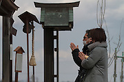 People come to a shrine on Hiyori yama  or Weather Hill to remember victims of the tsunami at  Miyagi, Japan. Friday March 11th 2016. 2016 marks the fifth anniversary of the Great East Japan earthquake. This magnitude 9 quake caused a tsunami that flattened large parts of the Tohoku coast killing around 18,000 people and triggering a nuclear disaster at Fukushima Daichi Power Station.