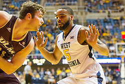 Dec 13, 2015; Morgantown, WV, USA; West Virginia Mountaineers guard Jaysean Paige (5) pressures Louisiana Monroe Warhawks guard Nick Coppola (11) during the first half at WVU Coliseum. Mandatory Credit: Ben Queen-USA TODAY Sports