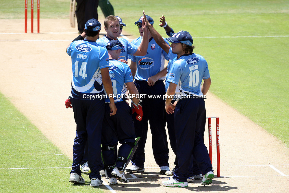 Auckland celebrate Micheal Bates wicket. Twenty20 Cricket, Auckland Aces v Pakistan, Colin Maiden Park, Auckland. Thursday 23 December 2010. Photo: Ella Brockelsby/photosport.co.nz