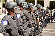 "29 JULY 2010 - PHOENIX, AZ: Phoenix police line up on Washington Street in Phoenix. Dozens of people were arrested during protests against SB 1070 across central Phoenix Thursday. US Judge Susan Bolton's ruling Wednesday stopped four of SB 1070's more than a dozen provisions from going into effect. She wrote, ""The court also finds that the United States is likely to suffer irreparable harm if the court does not preliminarily enjoin enforcement of these sections,"" she states in the ruling. ""The balance of equities tips in the United States' favor considering the public interest.""  PHOTO BY JACK KURTZ"