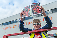 A young programme seller outside Oakwell, Barnsley prior to the Sky Bet League 1 Playoff Semi Final First Leg between Barnsley and Walsall<br /> Picture by Matt Wilkinson/Focus Images Ltd 07814 960751<br /> 14/05/2016