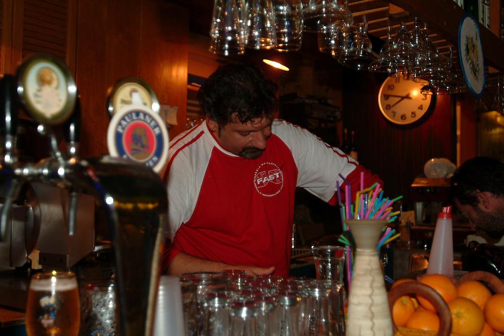 Bartender in cafe in Monterrosso, Cinque Terre, Italy