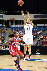 March 27, 2010; Sacramento, CA, USA; Stanford Cardinal guard Rosalyn Gold-Onwude (21) shoots over Georgia Bulldogs guard Jasmine James (10) during the first half in the semifinals of the Sacramental regional in the 2010 NCAA womens basketball tournament at ARCO Arena. Stanford defeated Georgia 73-36.