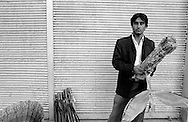 A young Iranian man, selling kites on the street. Tehran, Iran, 2007
