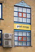 Good Energy sign and office building with air conditioning units, Chippenham, Wiltshire, England, UK