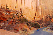 A motorist makes his way along the Burr Trail road in southern Utah, The Beehive state has countless scenic byways that provide stunning landscapes.