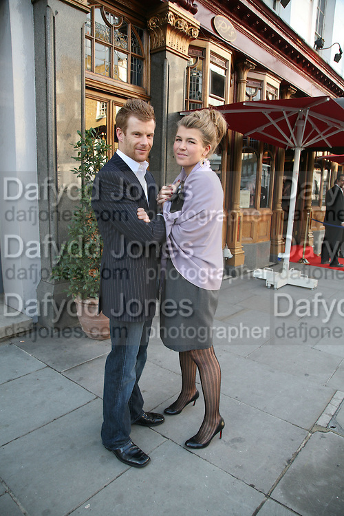 Amber Nuttall  and Tom Aikens, PJ's Annual Polo Party . Annual Pre-Polo party that celebrates the start of the 2007 Polo season.  PJ's Bar &amp; Grill, 52 Fulham Road, London, SW3. 14 May 2007. <br />
