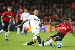 December 12, 2018 - Valencia, Spain - December 12, 2018 - Valencia, Spain - .Ruben Vezo of Valencia is tackled by Marcus Rashford of Manchester United during the UEFA Champions League, Group H football match between Valencia CF and Manchester United on December 12, 2018 at Mestalla stadium in Valencia, Spain (Credit Image: © Manuel Blondeau via ZUMA Wire)