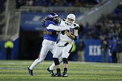 Kentucky linebacker Josh Forrest, left, tackles Charlotte quarterback Matt Johnson in the first quarter.<br /> <br /> The University of Kentucky hosted Charlotte, Saturday, Nov. 21, 2015 at Commonwealth Stadium in Lexington.