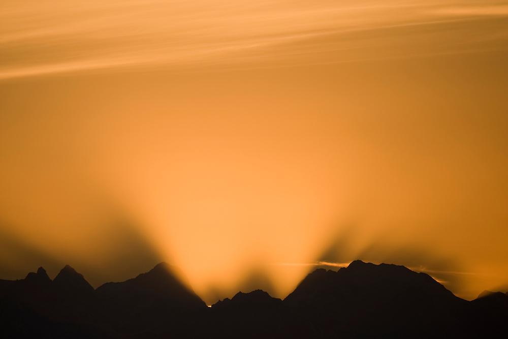 USA, Alaska, Glacier Bay National Park, Setting sun cast shadows over Fairweather Range mountains at sunset