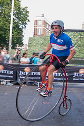 © Licensed to London News Pictures. 06/06/2015. London, UK.   Riders in the popular Penny Farthing race, as the 9th edition of the award winning Jupiter London Nocturne hits the streets of Farringdon.  The event brings the best criterium racing to the fast and technical race circuit around Smithfield Market, with a mix of elite and amateur races for male and female riders. Photo credit : Stephen Chung/LNP