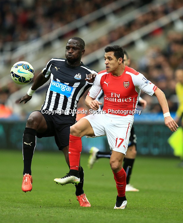 21 March 2015 - Barclays Premier League - Newcastle United v Arsenal - Alexis Sanchez of Arsenal in action with Moussa Sissoko of Newcastle United - Photo: Marc Atkins / Offside.