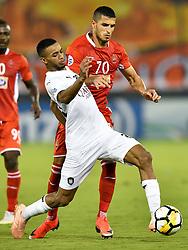 Salem Al Hajri (L) of Al Saad SC vies for the ball with Ali Alipour (R) Persepolis FC during the AFC Asian Champions League semi-finals first leg football match between Qatar's Al Saad and Iran's Persepolis FC at Jassim Bin Hamad Stadium Doha, Capital of Qatar, October 02, 2018. Persepolis FC won 1-0. (Credit Image: © Nikku/Xinhua via ZUMA Wire)